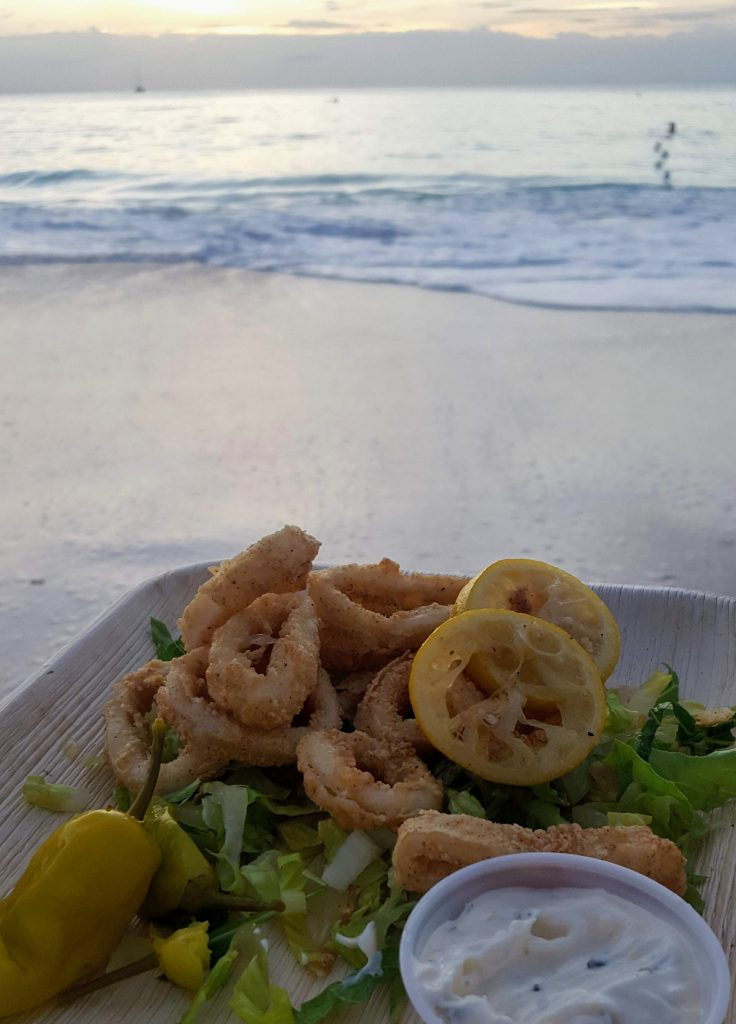 fried calamari on the beach watching the sunset