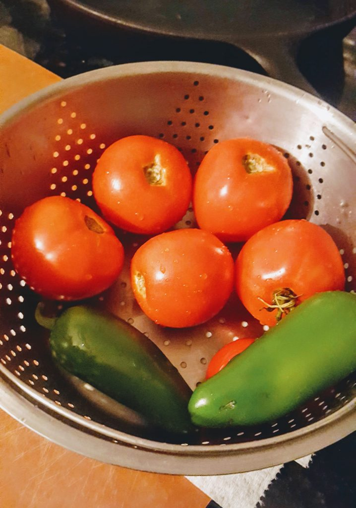 tomatoes and jalapenos in a colander